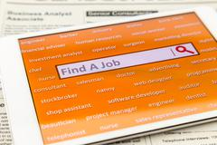 Find a job with online job search engine - stock photo
