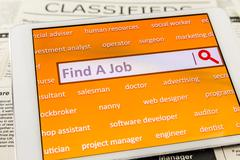 Use tablet search a job or  new career - stock photo