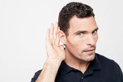 Can't hear clearly, eavesdropping. Stock Photos
