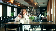 Sad woman sitting in the restaurant Stock Footage