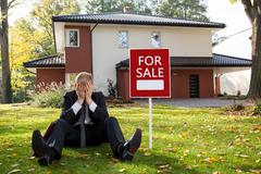 Estate agent sitting outside the house Stock Photos