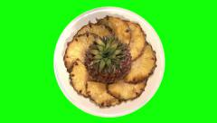 Pineapple and segments on plate, top shot Stock Footage