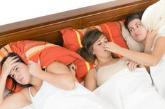 A snorer woman disturbing her roommates - stock photo