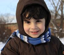 Little boy playing outdoors with snow Stock Photos