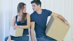 Man and woman are standing in an empty apartment - stock footage