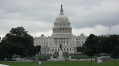 Wide shot of US Capital Building On Cloudy Day From Front Lawn Stock Footage