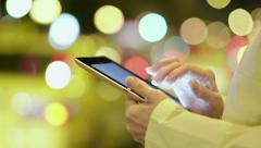 Close-Up Woman Using IPad In The Night City - stock footage