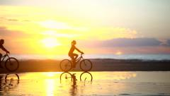 Couple Riding Bike at Beach - stock footage