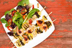 Shrimp Skewers on Plate with Veggies and Spices - stock photo