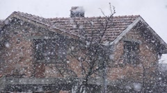 Snowflakes falling in slow motion with spectacular with background old house Stock Footage
