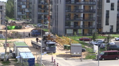 Crane unload block from truck trailer in construction site Stock Footage