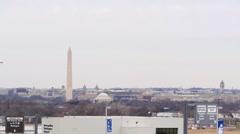 Airplane lading past DC skyline Stock Footage