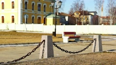 City park bench in sunny spring morning Stock Footage
