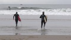 Oregon Coast Surfers Heading Out to Surf Stock Footage