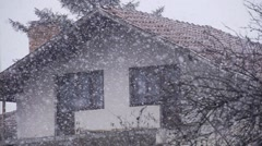 Snowflakes falling spectacular slow motion background with house Stock Footage