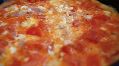 Omelet with vegetables and ham fried in a pan. Close up. Macro. HD. 1920x1080 Stock Footage