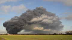 Giant smoke cloud from fire at tyre recycling plant, Sherburn,, United Kingdom Stock Footage