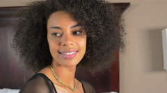 Attractive positive African American woman looking off and on camera smiling Stock Footage
