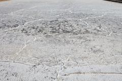 Sea water on dirt in salt farm become to be salt  after past processing sun b Stock Photos