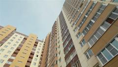 Low angle view of panel building. Pan shot from left to the right - stock footage