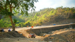 The construction of the road with difficulty. - stock footage