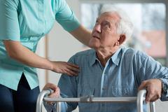 Disabled senior in care home Kuvituskuvat