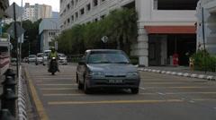 Traffic Over Farquhar Street near Eastern & Oriental Hotel - stock footage