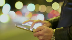 Close-Up Man Using IPad In The City - stock footage