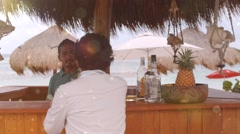 Drinking cocktail on the beach Stock Footage