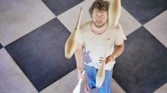 Caucasian juggler in practice - stock footage