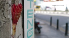 Rack Focus Shot from Chinese Incense to Pedestrians Stock Footage