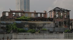 Tilting Shot of A Ruined Building and The Top of Komtar Tower Stock Footage
