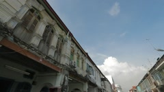 Tilting Shot from Blue Sky to A Small Street in Penang Stock Footage