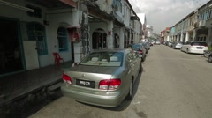 Tilt Shot from Penang's Street to Clear Blue Sky Stock Footage