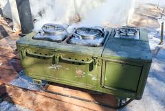 Mobile metal kitchen stove to feed soldiers Stock Photos