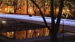 Illuminated bridge rails glows at night - stock footage