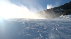 Snow cannon making fresh powder snow. Mountain ski resort and winter piste.. Stock Footage