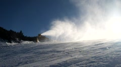 Snow cannon makes powder snow. Mountain ski resort and winter calm landscape. - stock footage