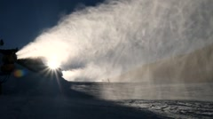 Snow making on slope. Skier near a snow cannon making fresh powder snow. Stock Footage
