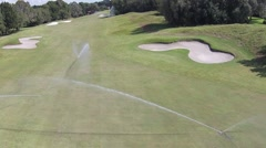 Golf Course sprinklers viewed from above - stock footage