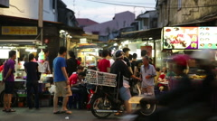 Motorbike with eggs strapped on seat in food vendor area Chulia St, Penang Stock Footage