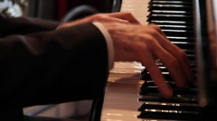 Pianist, hands on the keys of the piano Stock Footage