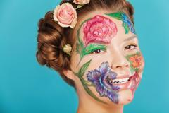 Close up portrait of woman model with hand drawing flowers on her face Stock Photos