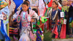 Pow wow grand entry of kids dancing Stock Footage