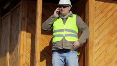 Engineer with cell phone Stock Footage