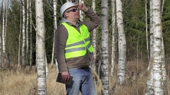 Forest engineer with tablet PC in birch grove Stock Footage