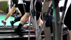 Legs on running track and orbitrack in gym Stock Footage