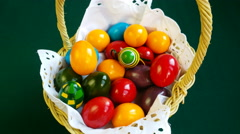 4K,Colorful Easter eggs inside straw wicker, ROTATING FOOD SERIES - stock footage