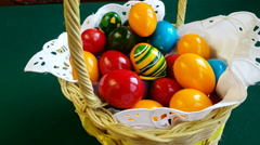 4K,Colorful Easter eggs inside straw wicker, ROTATING FOOD SERIES Stock Footage