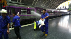 Cleaning international Butterworth Malaysia overnight sleeper train at Bangkok s - stock footage